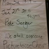 """Flipchart paper which says """"May 3rd 1919-Jan 21st 2014, 94 years, Pete Seegar, We shall overcome, Picturehouse Choir, we honour you"""""""
