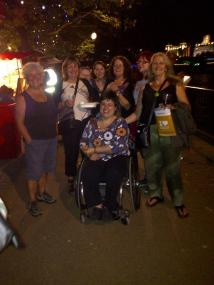 Choir members out on the banks of the Thames at night time