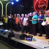 Picturehouse choir on stage in the Picturehouse at Band on the Wall March 2010