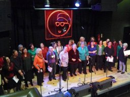 Blurred picture of the choir dancing during a performance March 2010