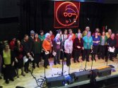 Blurred photo of choir dancing during a performance March 2010