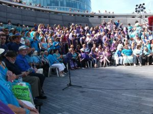 The choir with several hundred other people waiting to perform in the Scoop at More London 2011